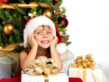 Pretty girl with present near the Cristmas tree Stock Images