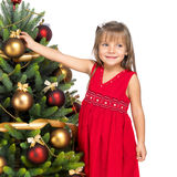 Pretty girl with present near the Cristmas tree Stock Photo