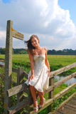 Pretty girl by public footpath Royalty Free Stock Photography