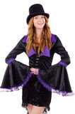 Pretty girl in purple carnival clothing and hat Stock Image