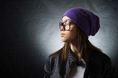 A pretty girl in a purple knitted hat Stock Photography