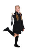 Pretty girl with a purse Royalty Free Stock Photography