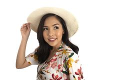 Pretty girl put one hand on white straw hat and looking to left Stock Photos