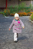 Pretty little girl qweek walking outside Royalty Free Stock Images