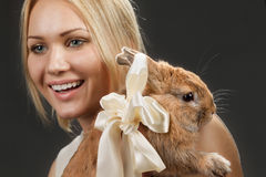 Pretty girl with a rabbit Stock Photo