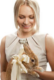Pretty girl with a rabbit Stock Photography