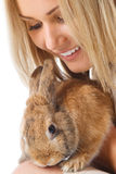 Pretty girl with a rabbit Stock Images