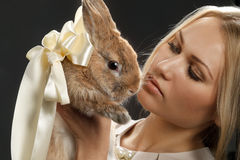 Pretty girl with a rabbit Royalty Free Stock Photo