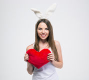 Pretty girl with rabbit ears holding heart Royalty Free Stock Photos