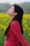 Pretty girl in rape flowers Stock Photo
