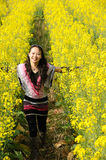 Pretty girl in rape flowers Stock Photo