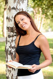 Pretty girl reading a book Stock Images