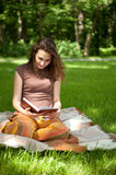 Pretty girl is reading book Royalty Free Stock Images