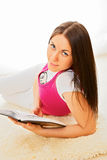 Pretty girl reading book indoor Stock Images
