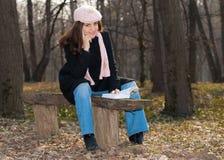 Pretty girl reading a book outdoors Royalty Free Stock Photos