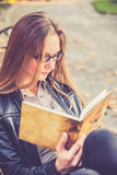 Pretty girl reading Royalty Free Stock Photography