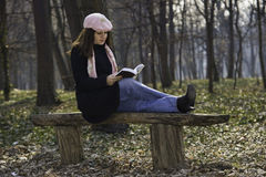 Pretty girl reading outdoors Stock Photo