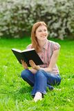 Pretty Girl Reading Outdoors Stock Photos