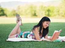 Pretty Girl Reading In The Park Royalty Free Stock Photos