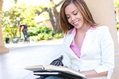 Pretty Girl Reading at School Royalty Free Stock Image