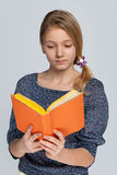Pretty girl reads book Royalty Free Stock Photo