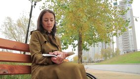 Pretty Girl Reads A Book Outdoors stock video
