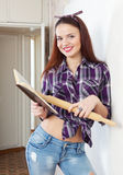 Pretty girl reads cookbook Royalty Free Stock Photos