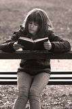 Pretty girl reads old book in the park Royalty Free Stock Image