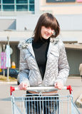 Pretty girl ready for shopping. On a parking near mall Royalty Free Stock Image