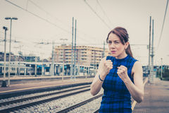 Pretty girl ready to fight along the tracks Stock Photos