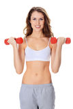Pretty girl with red barbells. Posing against white background Royalty Free Stock Image