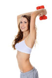 Pretty girl with red barbells Stock Photography