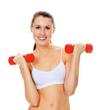 Pretty girl with red barbells. Posing against white background Stock Photos