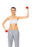 Pretty girl with red barbells. Posing against white background Stock Photo