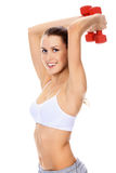 Pretty girl with red barbells Royalty Free Stock Images