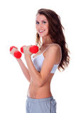 Pretty girl with red barbells. Posing against white background Royalty Free Stock Images
