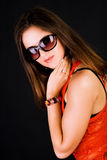 Pretty girl in red blouse and glasses Stock Photography