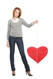 Pretty girl with red bounded heart Stock Photo