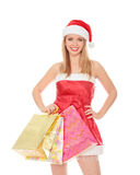 Pretty girl in a red Christmas hat Stock Photos