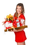 Pretty girl in red dres holding Christmas presents Stock Photos