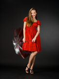 Pretty girl in red dress Royalty Free Stock Image