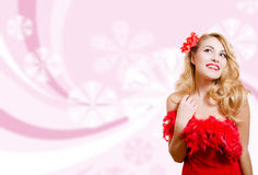 Pretty girl in red dress on blurred digital pink Stock Photography