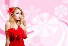 Pretty girl in red dress on blurred digital pink Royalty Free Stock Image