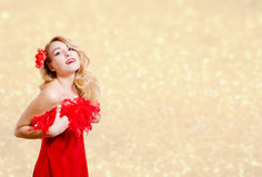 Pretty girl in red dress excited on bokeh lights. Picture of beautiful young lady in red dress surprised. Pretty girl excited on blurred bokeh party lights Royalty Free Stock Images