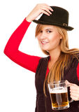 Pretty girl in red drinking beer from the mug Royalty Free Stock Image