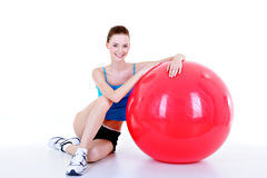 Pretty girl with red fitball Royalty Free Stock Photo