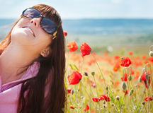 Pretty girl with red flowers Royalty Free Stock Photography
