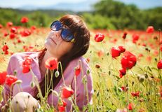 Pretty girl with red flowers Stock Photography