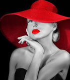 Pretty girl in red hat Stock Images
