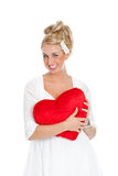 Pretty girl with red heart. Pretty girl with big smile holding a red valentine heart Stock Photo
